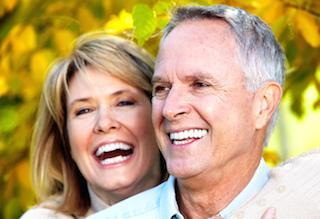laughing couple | dental implants in prairieville la