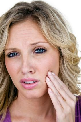 woman with tooth pain | emergency dentist prairieville la