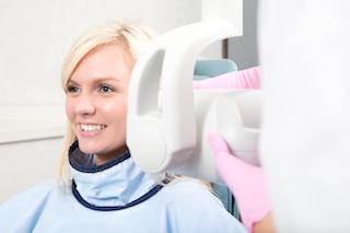 woman getting x-ray | dental extractions prairieville la