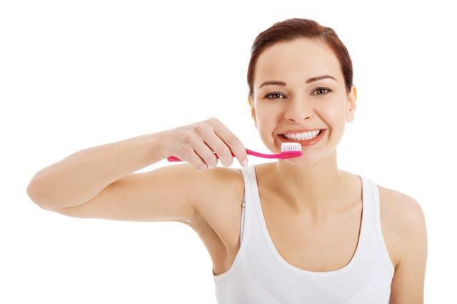 woman brushing | dental cleanings and exams prairieville la