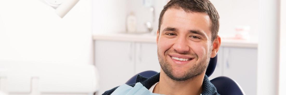 brown haired male with TMJ waiting in dentist chair