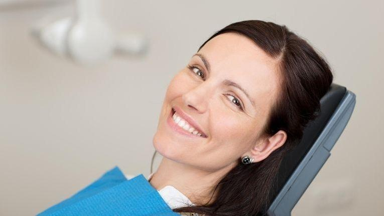 Woman smiling in dental chair | Prairieville LA Dentist