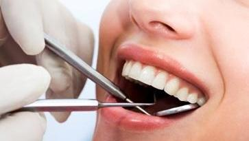 dentist performing a dental exam | preventative dentistry prairieville la