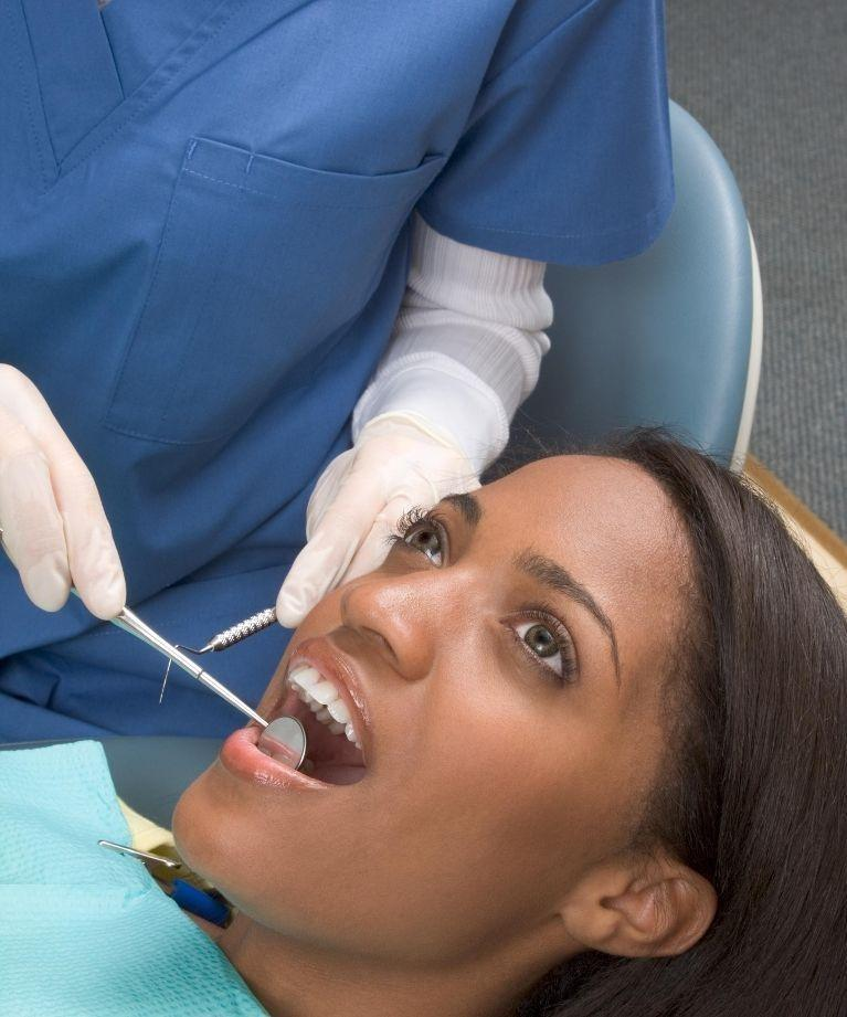 woman in dental chair | Dentist in Prairieville LA